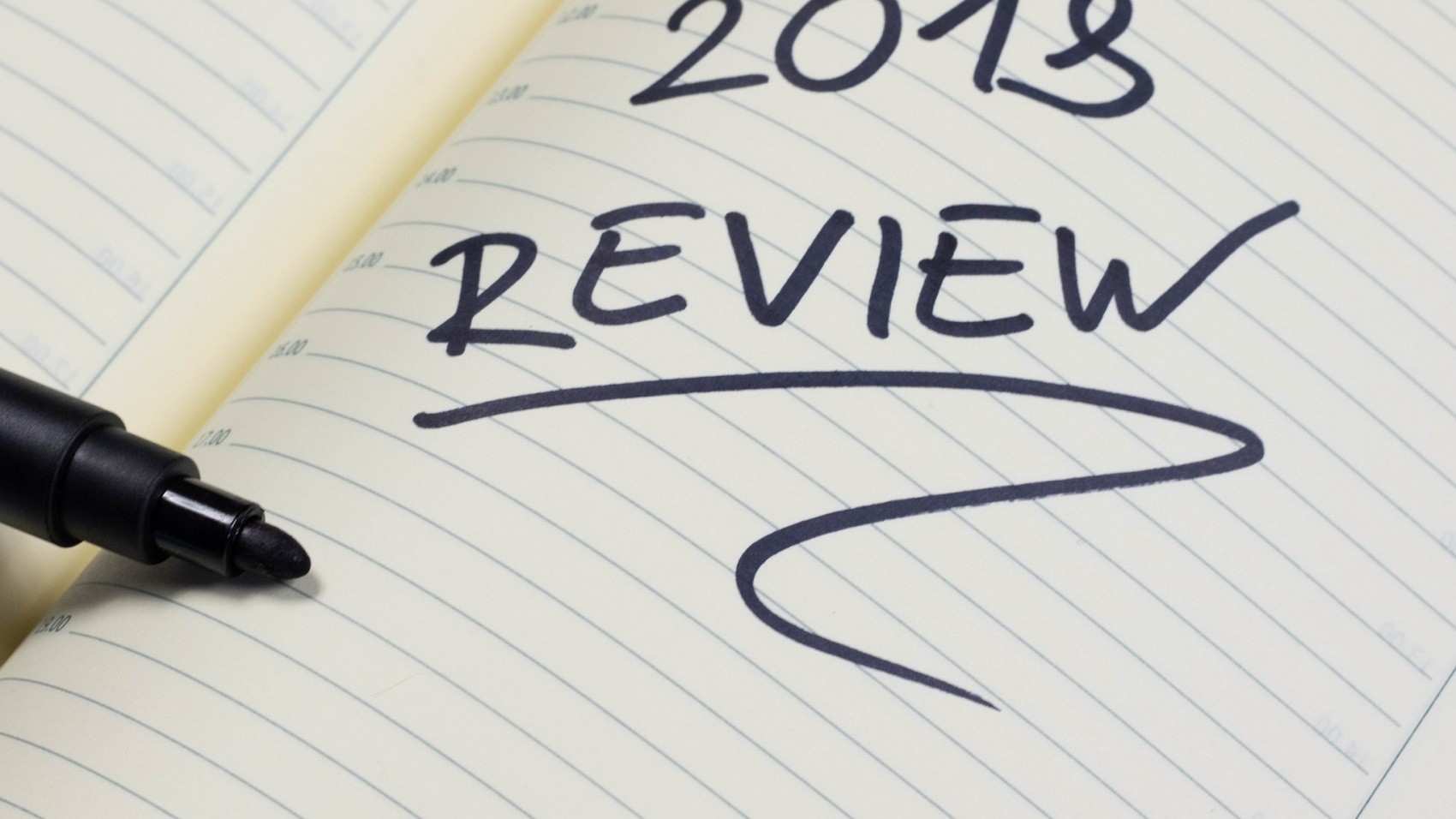 Notebook with 2018 Review written on it